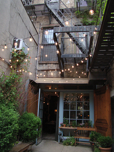 minimalist outdoor string lighting staircase